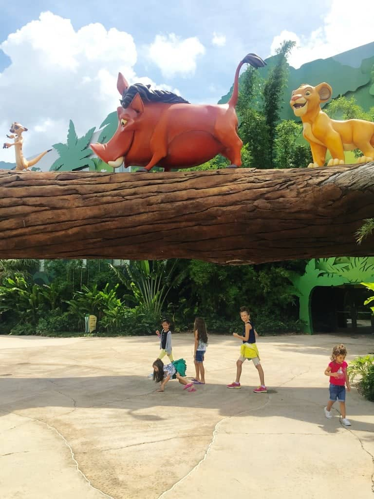 Bigger than life-size Simba, Timon, and Pumbaa outside the Art of Animation Disney Family Suites - the perfect Disney World accommodations for large families.