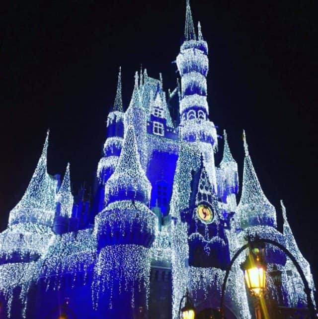Cinderella Castle with icicle lights at Mickey's Very Merry Christmas Party