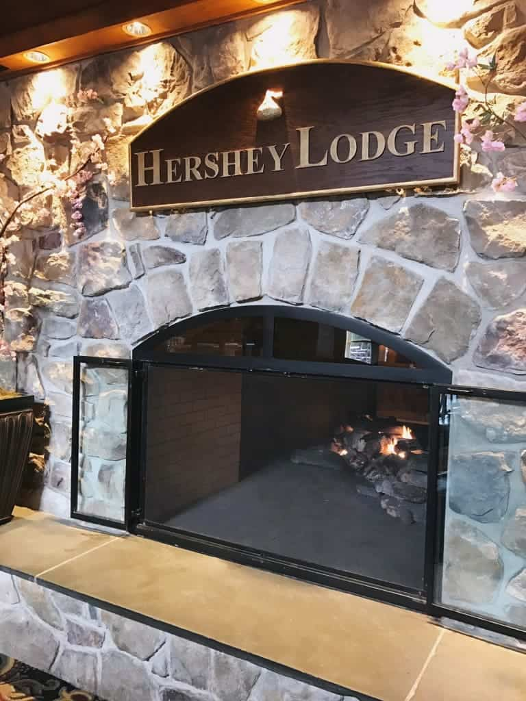 5 Reasons why you should stay at the Hershey Lodge. One of them is the warm fireplace.
