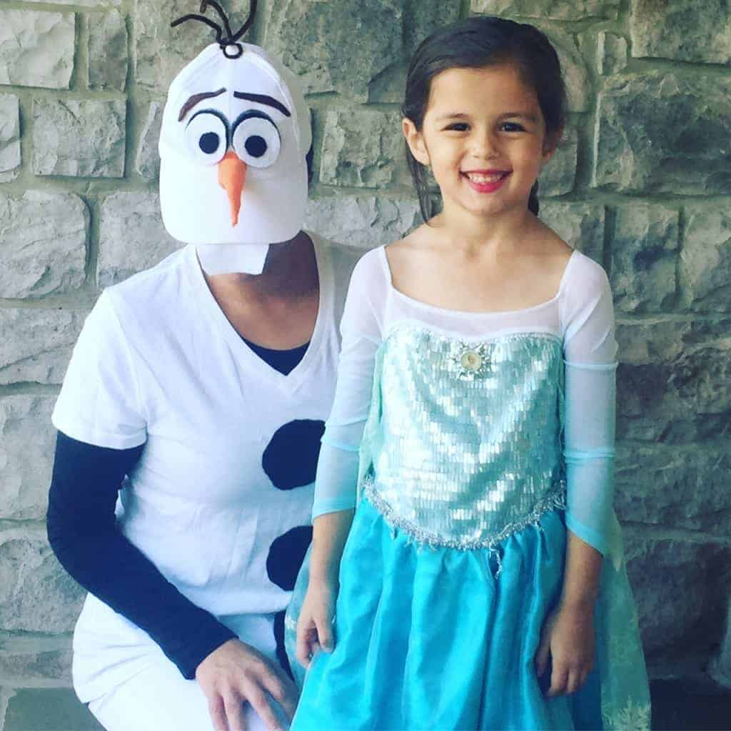 Princess Elsa and Olaf are a snap with this easy Halloween costume for moms and children. The cold never bothered them anyway.