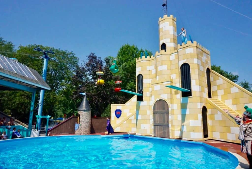 Divers dive from 70 feet into a 9 foot deep pool at Dutch Wonderland.