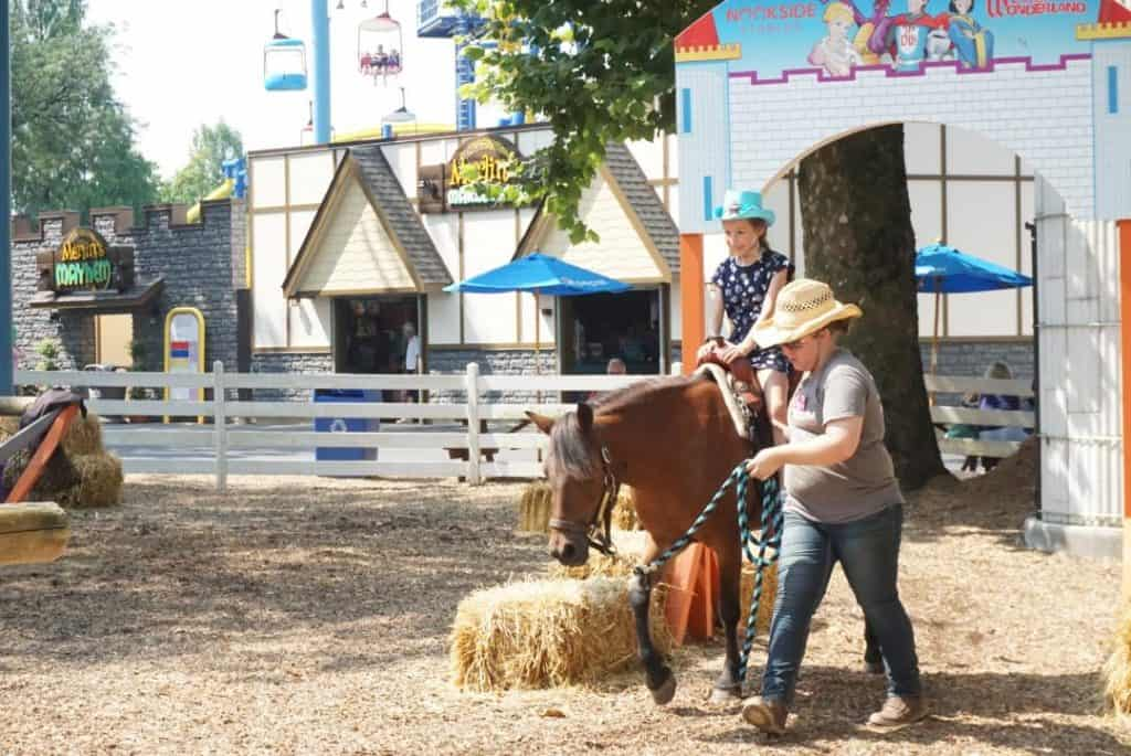 You can ride a pony at Dutch Wonderland for an extra cost.