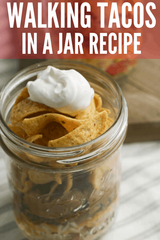 Try this easy Walking Taco in a jar! It's a cross between Frito Pie and Walking Tacos. This quick family dinner recipe takes less than 30 minutes to make and is great for parties, too!