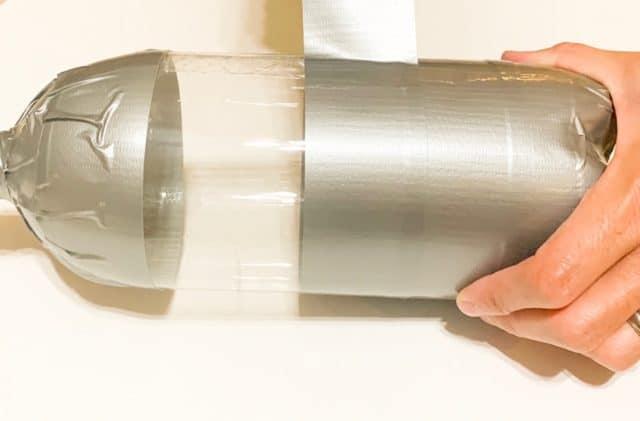 Wrap Duck Tape around soda bottles for Scuba Diver costume